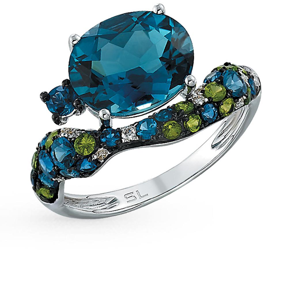 Фото «золотое кольцо с гранатом, топазами, сапфирами и бриллиантами»