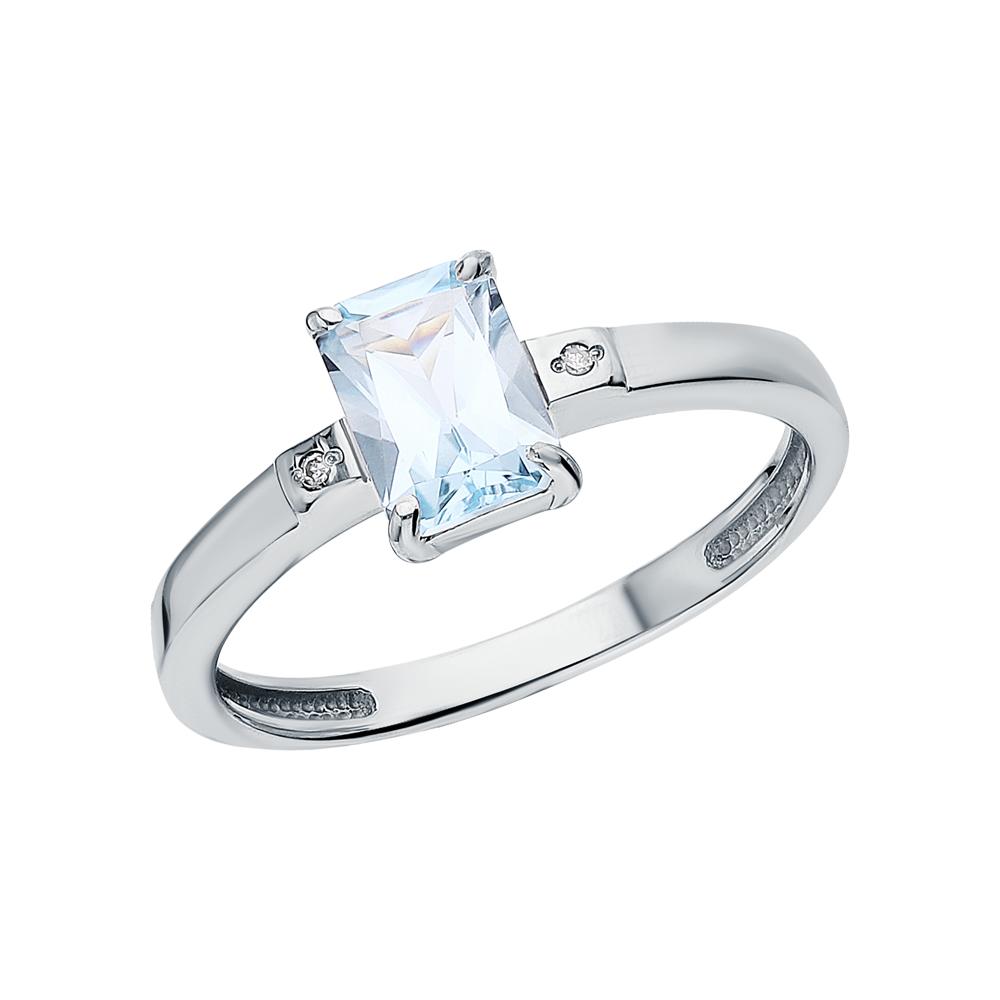 Фото «Серебряное кольцо с топазами и бриллиантами»