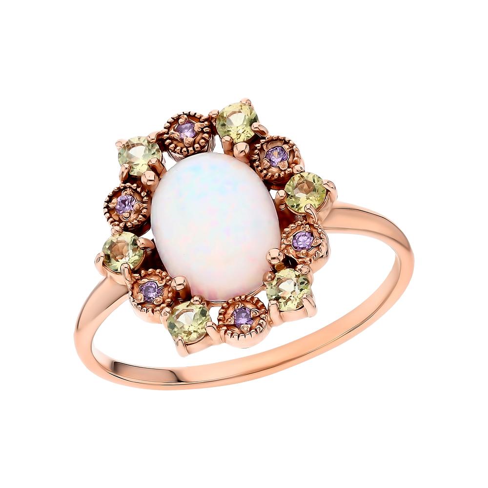 Фото «Золотое кольцо с хризолитом, фианитами и опалами имитациями»