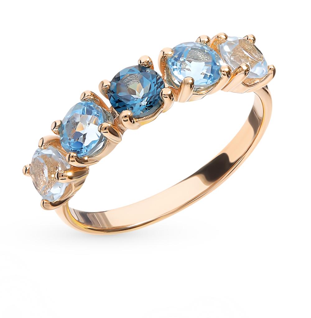 золотое кольцо с топазами