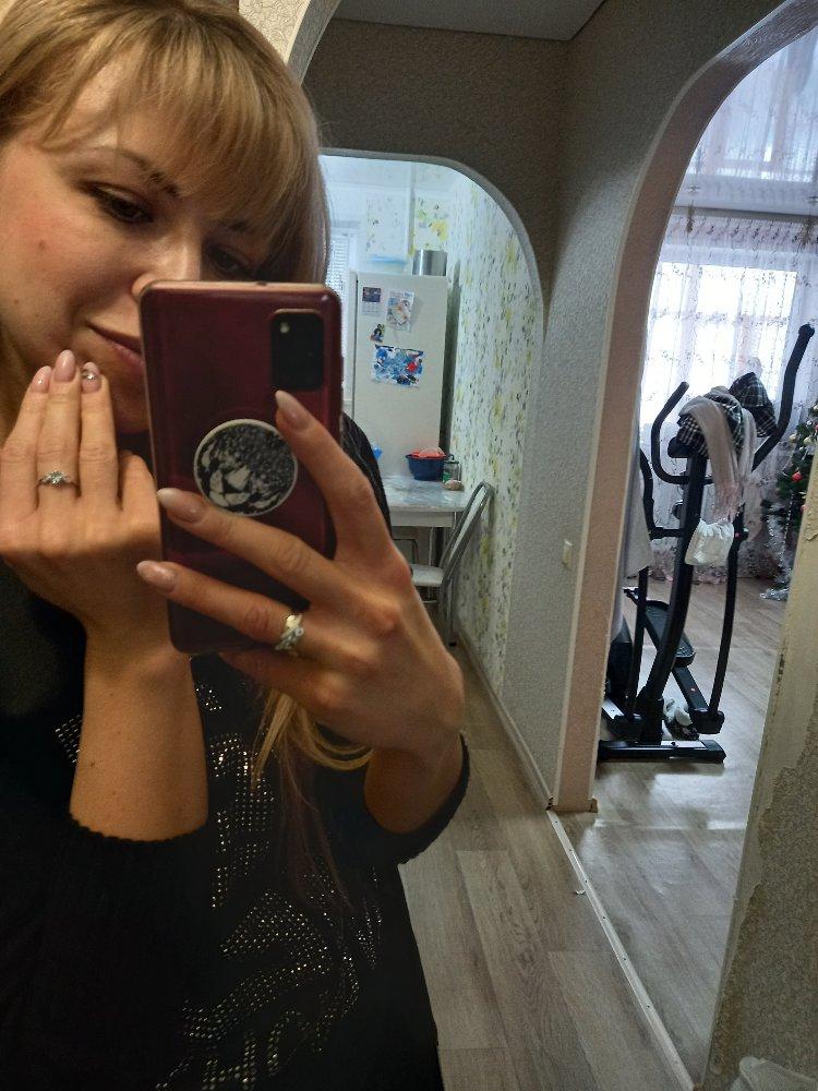 Очень красивое кольцо, ношу не снимая, топазы переливаются нежно- голубым