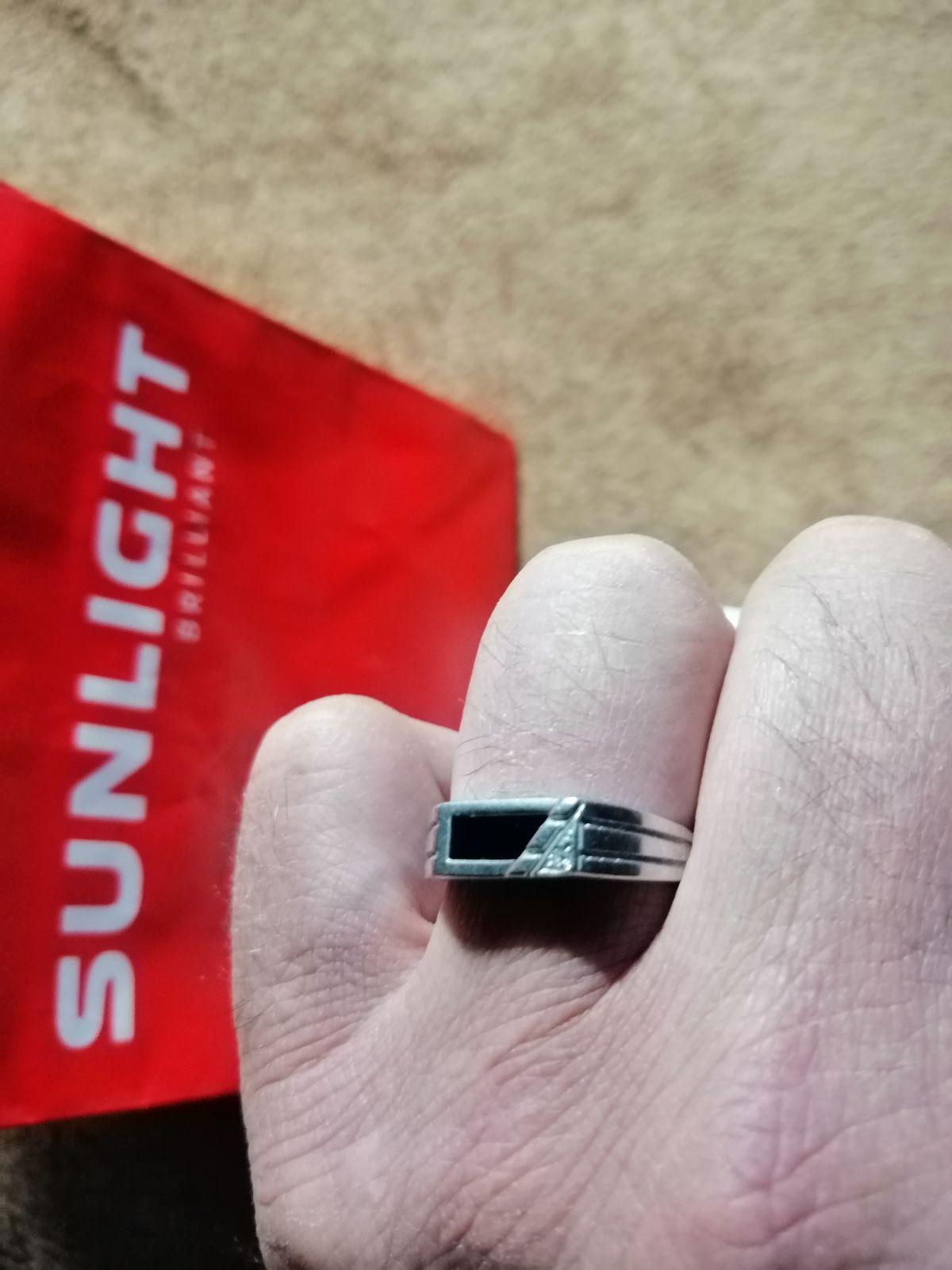 Кольцо с ониксом.